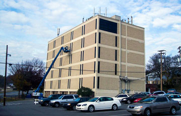 Executive Office Building - Western craftsmen address waterproofing issues