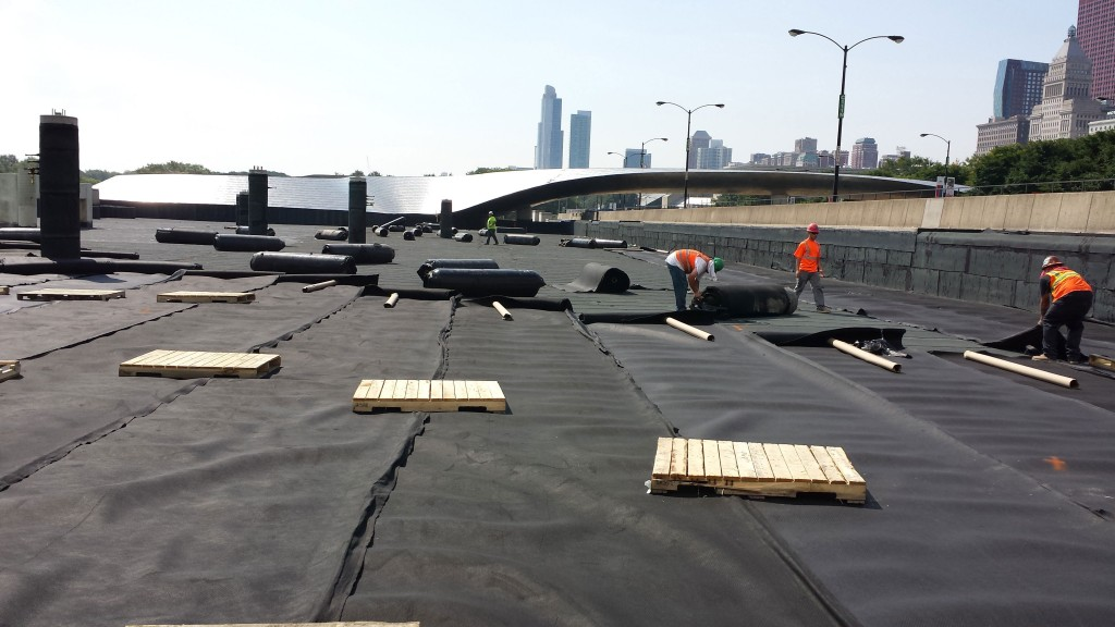 installing drainage mat on waterproofing system